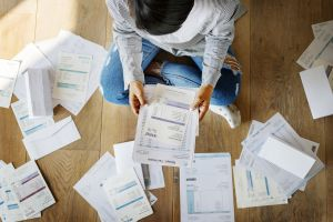 Woman sitting with a pile of papers
